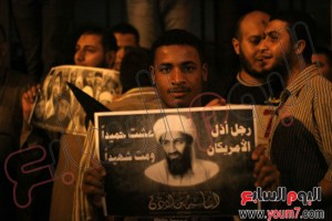 Musim Brotherhood in Egypt Carrying Ossama Bin laden pictures in Egypt and typed on it that's the hero who humiliated all Americans