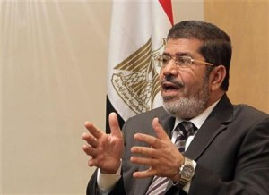 Mohamed Mursi, head of Muslim Brotherhood's political party, and Brotherhood's new presidential candidate, talks during interview with Reuters in Cairo