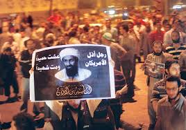 "muslim brotherhood supporters carrying Ossama Bin laden picture, written:""Bin Laden, the man who humiliated the America, is a brave and a hero. Nasr city, Cairo"