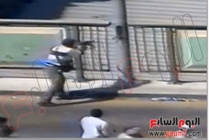 A brotherhood killer holding a machine gun shooting at people at homes cairo 16 august 2013