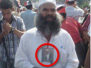 A brotherhood supporter on the 17th of August carrying Bin Laden Picture