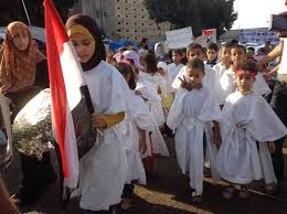 children forced to wear shrouds and kept in armed sit-in