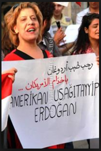 The sign says Erdogan servant and slave of the USA