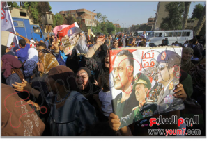 Egyptian in Kirdassa are raising images of Ltae president Sadat and Nasser and Sisi Minister of defence