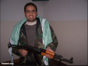 Mohamed Adel 6 of April Movement carrying a machine gun