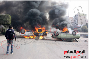 Muslim Brothers supporters and students damaging and burning properties in Nasr city